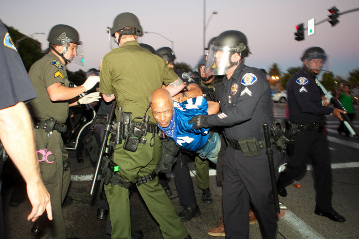 Police officers take a man into custody after he refused to disburse during a demonstration to show outrage for the fatal shooting of Manuel Angel Diaz, 25, at Anaheim City Hall on July 24, 2012 in Anaheim, California. Diaz was fatally shot on July 21 by an Anaheim police officer and has sparked days of protests by the angered community.