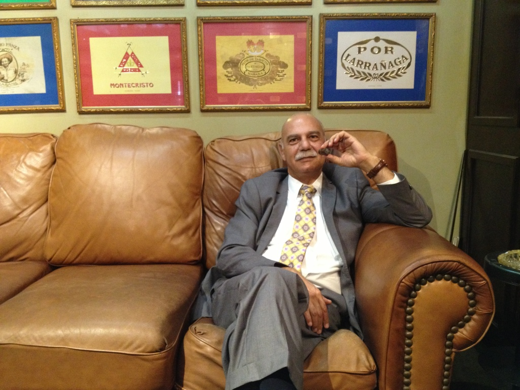 Anto Kamarian enjoys a cigar in his Pasadena, Calif., cigar shop