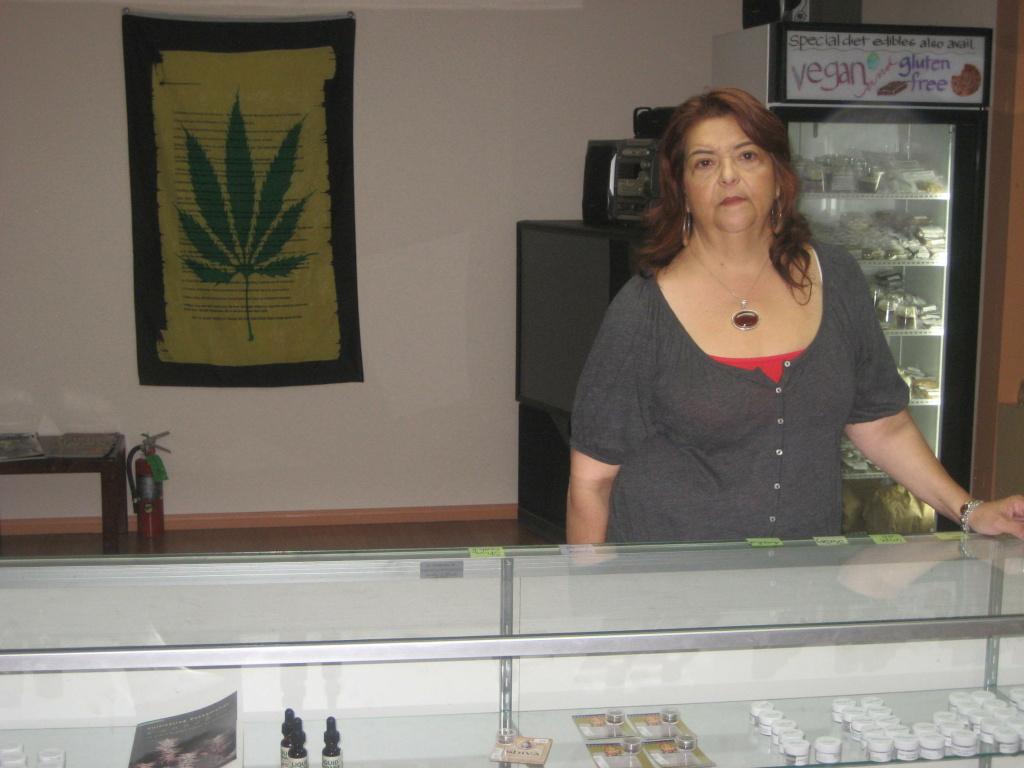 Yamileth Bolanos in the trading room of PureLife Alternative Wellness Center