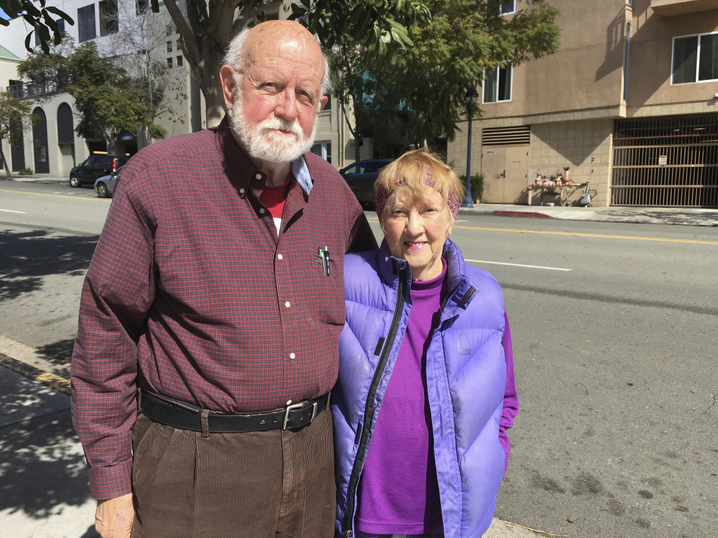 In this Feb. 23, 2018 photo Air Force veteran Ed Warren, 82, and his wife, Jac Warren, 81, pose for a photo while visiting San Diego, to attend the Democrats' annual convention and talk to lawmakers. The couple is voicing opposition to a regulation that requires veterans in state homes to be discharged before they can use a new state law allowing physician-assisted deaths for the terminally ill.