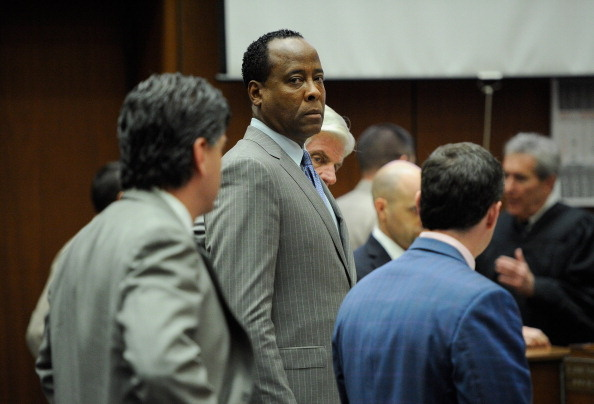 In this file photo, Dr. Conrad Murray, surrounded by his defense attorneys, looks on after the defense rested their case in his involuntary manslaughter trial in the death of singer Michael Jackson at the Los Angeles Superior Court on November 1, 2011 in Los Angeles, California.