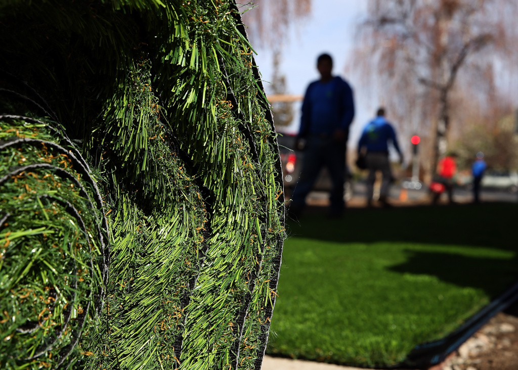 A roll of an artificial lawn waits to be installed in front of an apartment building by Better Than Real Artficial Lawns on January 30, 2014 in San Jose, California.