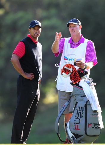 THOUSAND OAKS, CA - DECEMBER 04:  Tiger Woods plays a shot to the second green as his caddie Joe Lacava looks on during the final round of the Chevron World Challenge at Sherwood Country Club on December 4, 2011 in Thousand Oaks, California.  (Photo by Scott Halleran/Getty Images)