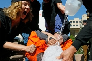 Marietta Hedges yells at volunteer torture victim Maboub Ebrahimzdeh as human rights activists demonstrate water boarding in front of the Justice Department in Washington DC.