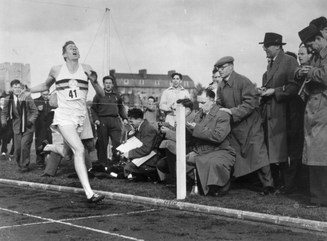 Roger Bannister about to cross the tape at the end of his record breaking mile run at Iffley Road, Oxford. He was the first person to run the mile in under four minutes, with a time of 3 minutes 59.4 seconds.