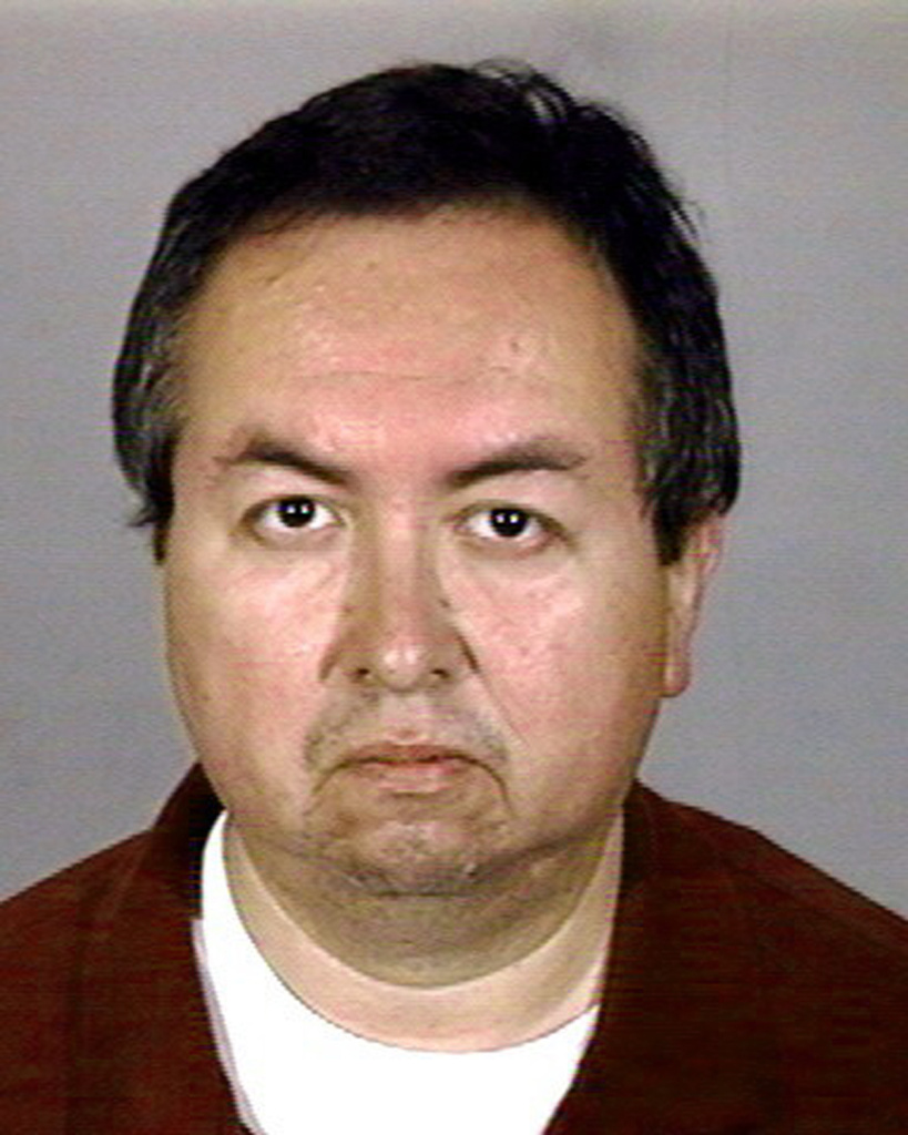 This police booking mug from the Los Angeles Police department shows former Catholic priest Carlos Rene Rodriguez, 46, after he was arrested at his home in the City of Commerce, Calif., in Sept. 2002. Rodriguez was charged with molesting a 12-year-old altar boy over a two-year period ending in 1987, police Lt. Horace Frank said.
