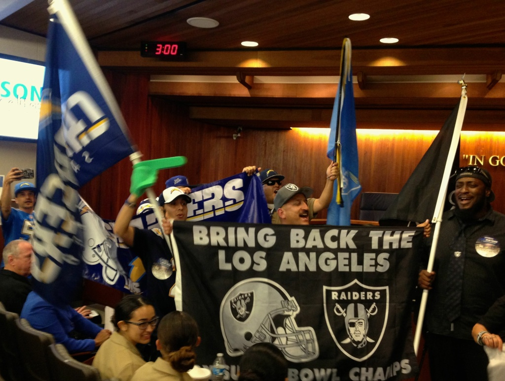 Supporters of an NFL stadium marched into the Carson city council meeting Tuesday night.