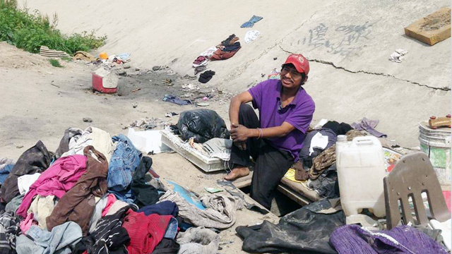 Abimael Martinez lives in a hole he dug in the Tijuana River channel, a short walk from the U.S.-Mexico border.
