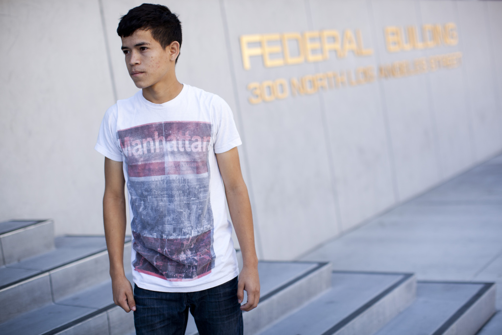 File photo: Christhian Amaya, 17, outside of the Federal Building in downtown Los Angeles after being approved for a green card. His case has been in the immigration courts for one year after he crossed into America from his home country of Honduras.