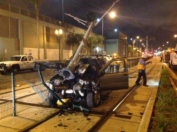 Suspected drunk driver crashes into Expo Line power pole and damages overhead wires.