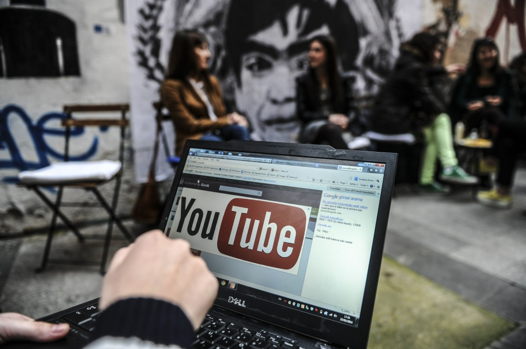 A person uses a laptop computer showing Youtube's logo on March 27, 2014 in Istanbul.