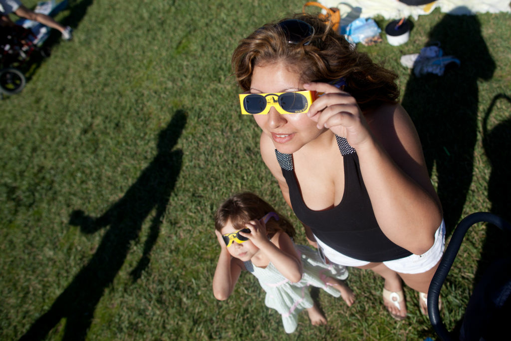 Kimberly Huber and her daughter Clarity, 4, view the transit of Venus on June 5, 2012 at Griffith Observatory. The Observatory will be closed during Monday's transit.