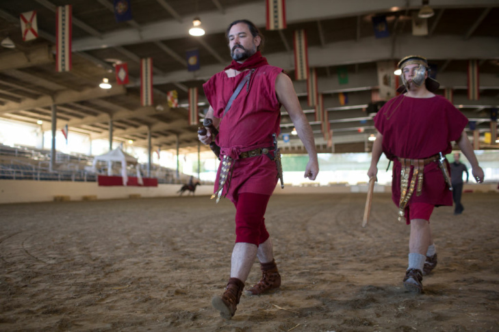 Peter and Carly Hopkins dress in their Roman costumes for the performance of Spartacus and the Roman Legion at the Equestrian Center in Griffith Park.