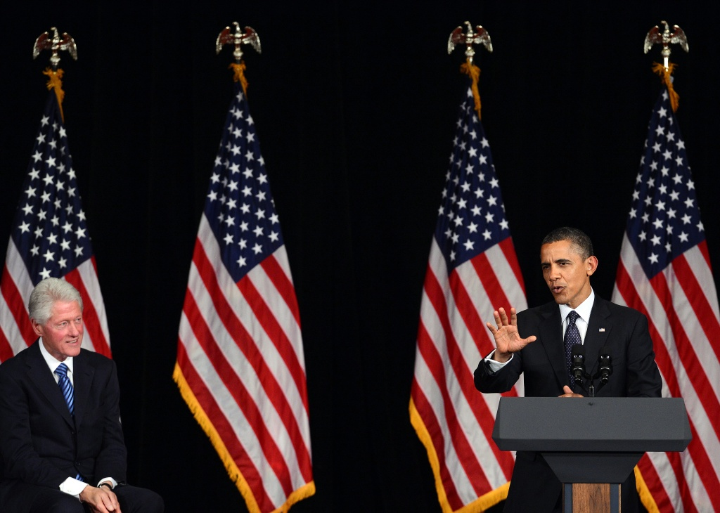 US President Barack Obama (R) speaks as former President Bill Clinton looks on during a campaign event in New York on June 4, 2012.