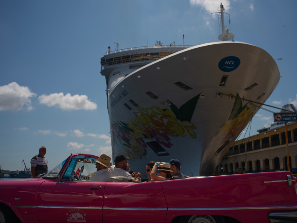 Tourists who have just disembarked from a cruise liner tour Havana, Cuba, on Tuesday. The Trump administration has imposed major new travel restrictions on visits to the island by U.S. citizens.