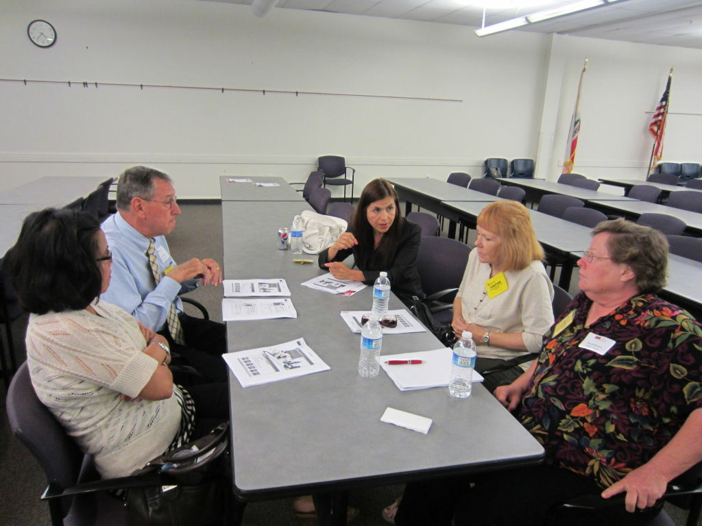 Five officials from Whittier City School District debrief after a local presentation on the governor's May revision of the budget. (May 25, 2012)