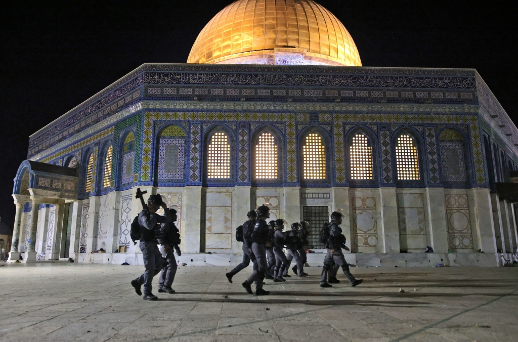 Israeli security forces deploy next to the Dome of the Rock mosque amid clashes with Palestinian protesters at the Al-Aqsa mosque compound in Jerusalem on Friday.