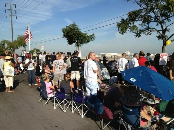Rows of portable chairs now spill onto Imperial Ave. in El Segundo, where hundreds vie for a good view of the LAX tarmac. The Endeavour is expected to land at the airport around 11:30 a.m.