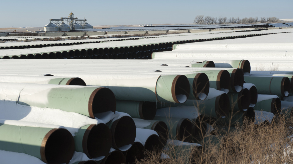 File: Pipes for TransCanada's planned Keystone XL pipeline are stored in Gascoyne, N.D. The White House on Tuesday threatened to veto the first piece of legislation introduced in the Republican-controlled Senate, a bill approving the much-delayed Keystone XL oil pipeline.