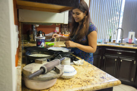 Shalini Sharma at her home in Irvine, Calif. on Tuesday, Jan. 6, 2015. Sharma worked as an architect in India. But as a dependent on her husband's work permit, she has not been allowed to work since they arrived in the U.S. six years ago. A new policy will allow dependent spouses like her to apply for their own work permits starting in May.