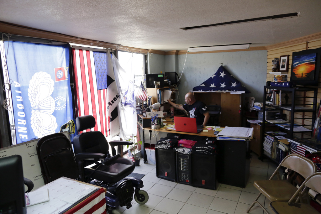 "In this Feb. 13, 2017 photo, U.S. veteran Hector Barajas, who was deported, works in his office at the Deported Veterans Support House, nicknamed ""the bunker"" in Tijuana, Mexico."