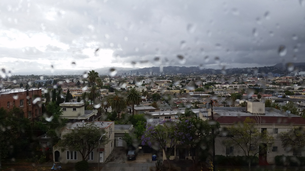 View of Hollywood from Silver Lake after light showers Saturday. An earlier storm dumped an inch of rain and a foot of snow in Northern California.