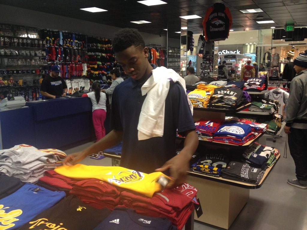 Jvaughn Singleton folds a Lakers t-shirt at Pro Image Sports
