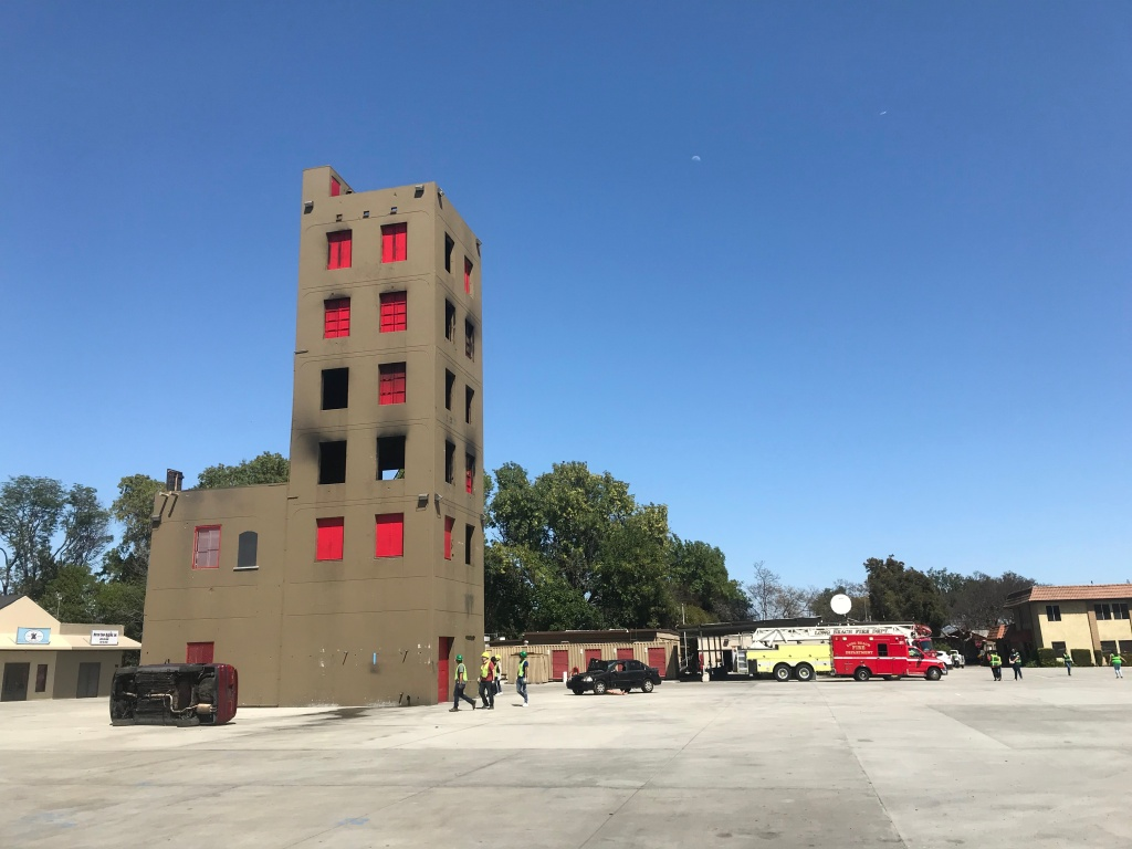 CERT participants fan out in search of victims at the beginning of the drill at the Long Beach Fire Department training grounds.