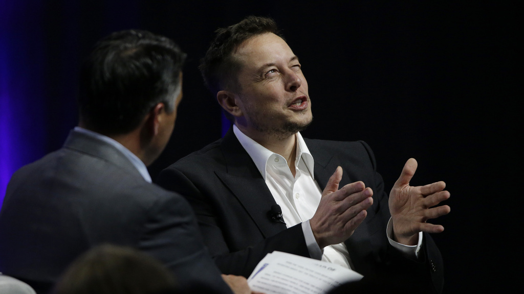 Tesla and SpaceX CEO Elon Musk responds to a question by Nevada Republican Gov. Brian Sandoval during the third day of the National Governors Association's meeting on Saturday in Providence, R.I. Among other things, Musk warned governors that artificial intelligence poses a