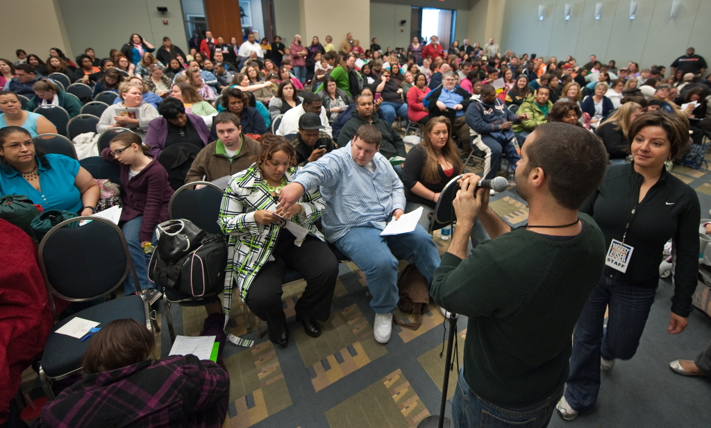 Casting director Marc Levine explains the process to the crowd of well over 500 people waiting during an open audition to be on the popular TV show,