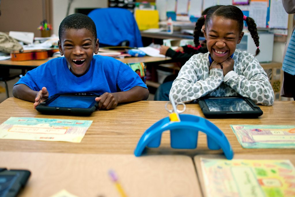Second graders at Baldwin Hills Elementary students react as they get their iPads for the first time on Friday, Nov. 15. Baldwin Hills is the final school to receive iPads as part of LAUSD's pilot program.