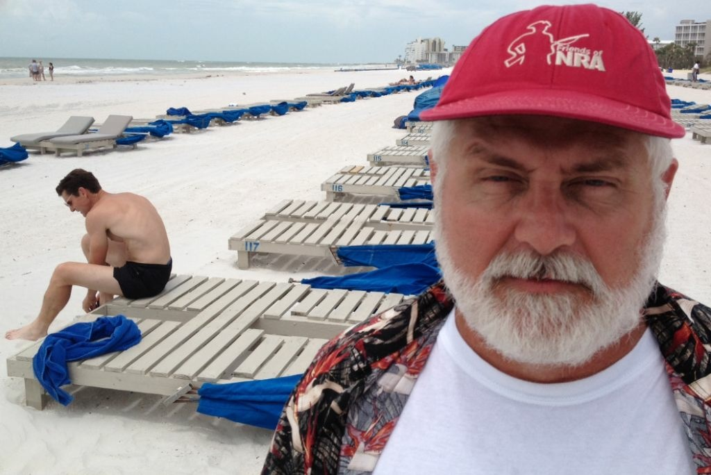 Earl DeVries, a diesel engine salesman from Ontario, is managing a daily trip to the beach at the Republican National Convention.