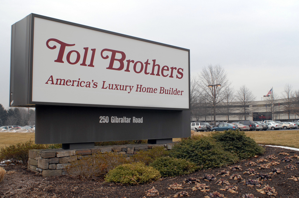 A Toll Brothers sign rests outside the corporate headquarters in Horsham, Pennsylvania.
