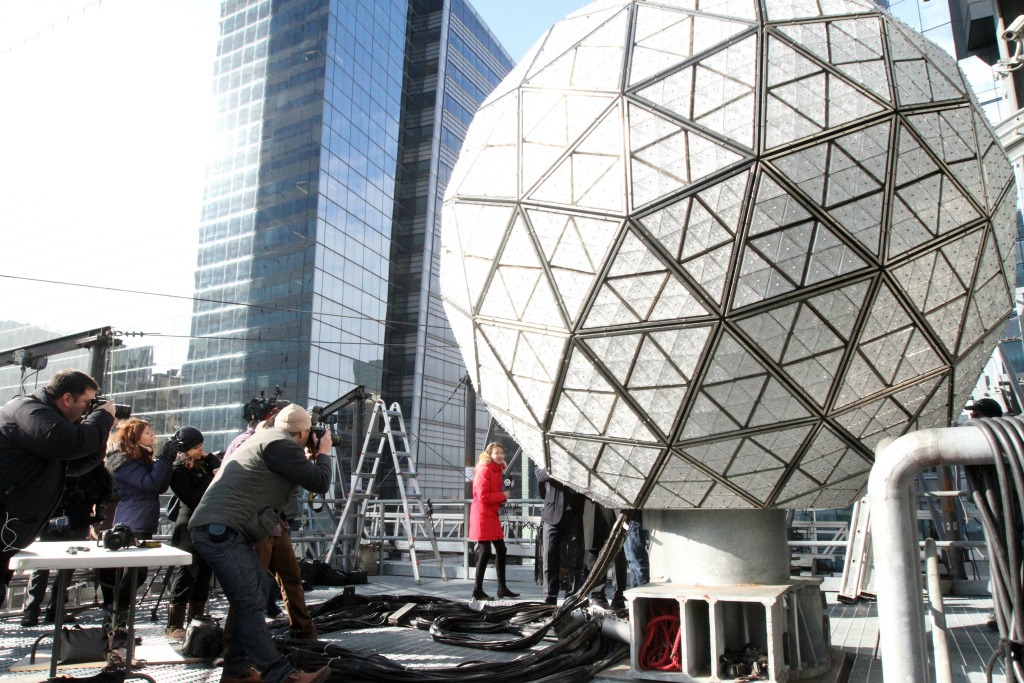 The New Year's Eve Ball is photographed on the roof of One Times Square in New New York during a media event where several of the Waterford Crystal triangles were installed on the ball on Friday Dec. 27, 2013. (AP Photo/Tina Fineberg)