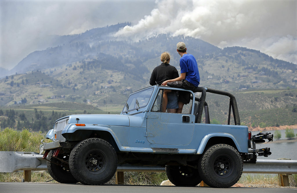 Michelle Mellenthin and Chris Huizenga watch firefighting efforts from a Jeep on June 11, 2012 near Laporte, Colorado. The High Park Fire in Larimer County has burned almost 37,000 acres and damaged or destroyed more than 100 structures.