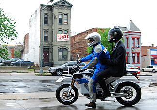 NPR's Guy Raz rides behind Zero Motorcycles' Neal Saiki on the 2010 Zero S street bike.
