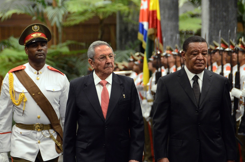 Cuban President Raul Castro (C) welcomes Ethiopian President Mulatu Teshome Wirtu (R) at the Revolution Palace in Havana, on January 9, 2018.