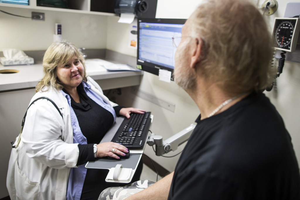 Family Nurse Practitioner Stacey Nadler, left, gives Chance Rearden, 66, a check-up at Saban Community Clinic.