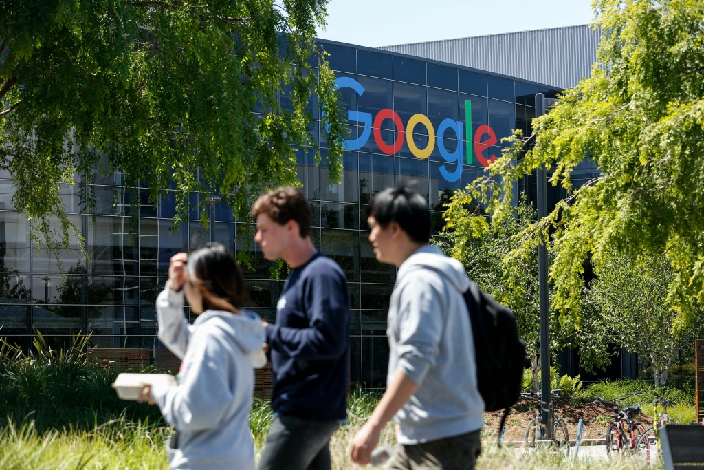 People walk in Google's main campus