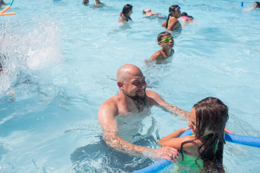 A father and daughter play at the Glassell Park Pool in this June 28th, 2013 file photo. Starting Friday, temperatures are expected to range from 105 to 117 in parts of Imperial, Riverside and San Bernardino Counties.
