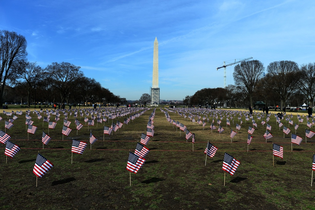 Some 1,892 American flags are installed on the National Mall in Washington, DC in 2014. The Iraq and Afghanistan veterans installed the flags to represent the 1,892 veterans and service members who committed suicide this year as part of the