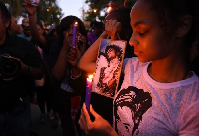 A candlelight vigil for Prince is held at Leimert Park in Los Angeles on April 21, 2016.