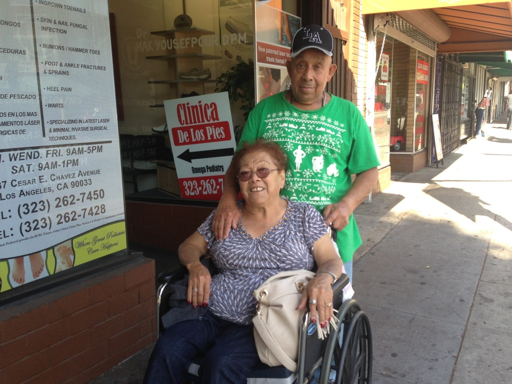 Porfirio Torres, 74, pushes his wife Berta, 68, up Cesar Chavez Avenue in Boyle Heights. They say they've already broken one wheelchair because of the uneven sidewalks.