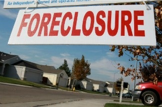 A sign is seen in front of a foreclosed home in Rio Vista, California.