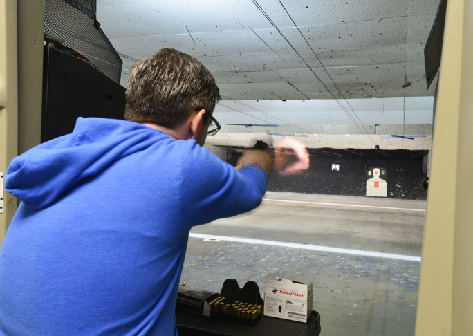 Brendan, who declined to give his last name, practices on the pistol range at On Target in Laguna Niguel on Saturday April 12 2014.