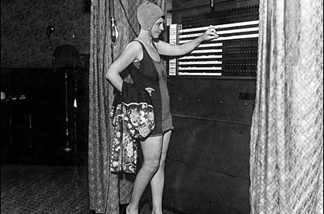 Numerous voters, desiring to spend the holiday at the beaches, dropped into their polling places clad in bathing suits on August 26, 1930. Here is Mrs. Lucile Wheat.