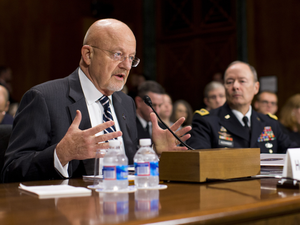 National Intelligence Director James Clapper, left, accompanied by National Security Agency Director Gen. Keith Alexander, testifies on Capitol Hill in Washington on Wednesday.