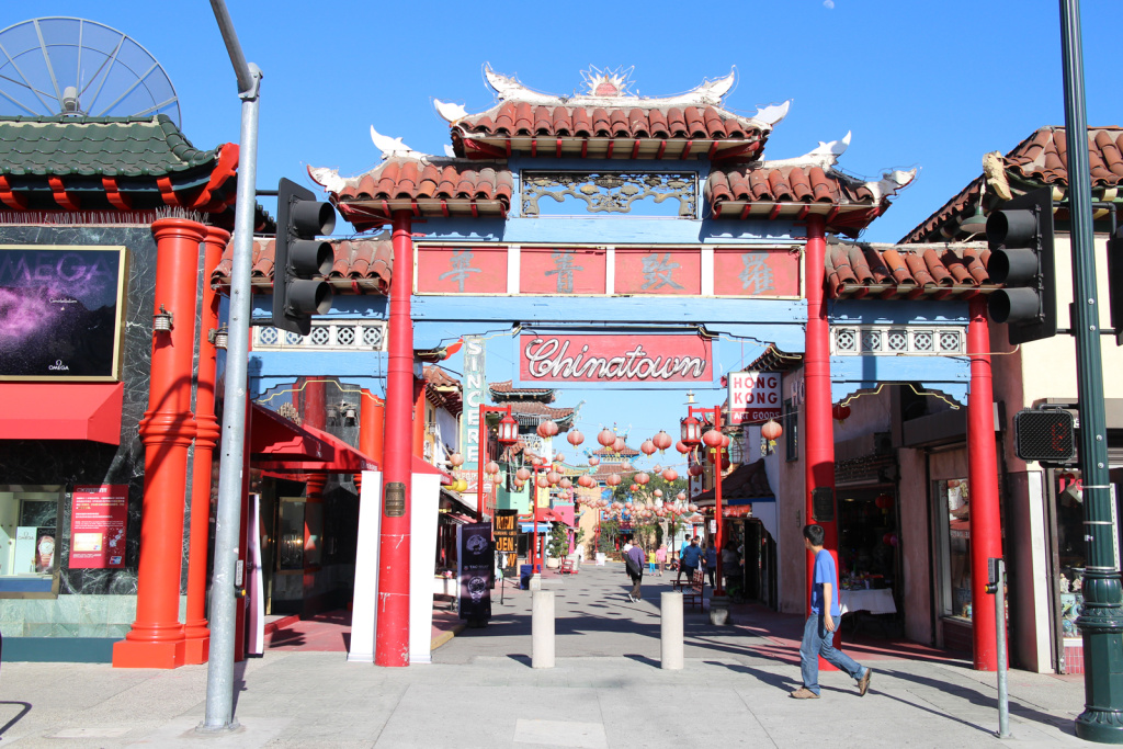 A pedestrian walks past the iconic entrance to Chinatown in downtown Los Angeles.