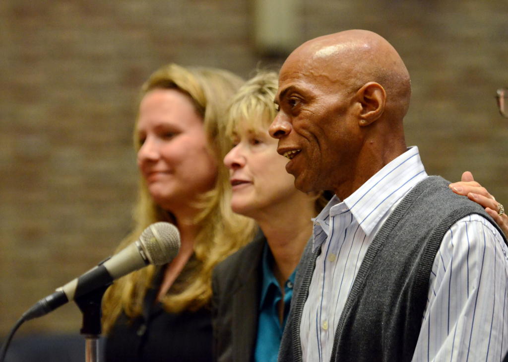 Edward Lee Elmore, right, is accompanied by his lead counsel Diana Holt, center, and previous counsel Marta Kahn, during his hearing.