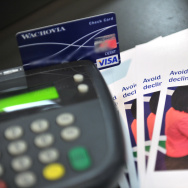 A photo illustration shows a debit card